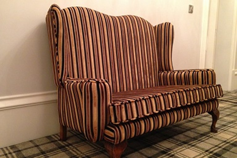 Contemporary fabric on an antique sofa